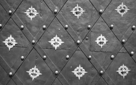 Antique decorated metal door background photo