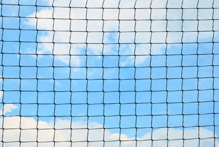 Simple sport safety net against a cloudy sky photo