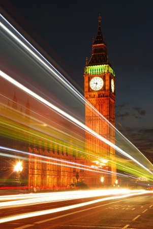 Big Ben Clock Tower in the evening with traffic lights trails photo