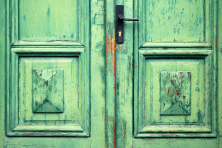 Old flaked classic green door and door handle photo