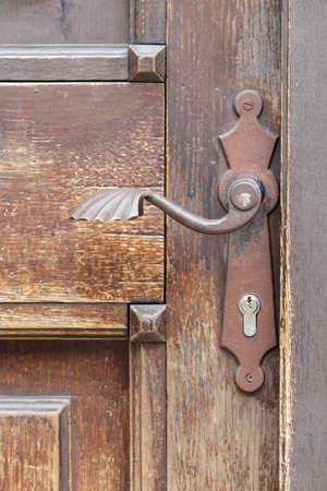 Rusty door handle and old door photo