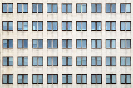 multiple: Multiple closed windows on a large office building
