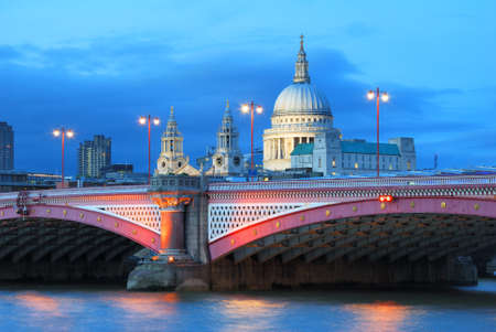 Saint Pauls Cathedral with evening lights and sky
