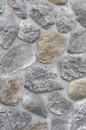 Abstract background paving consisting of big stones embedded in cement photo