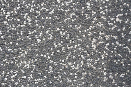 topdown: Abstract background paving consisting of small pebbles embedded in cement