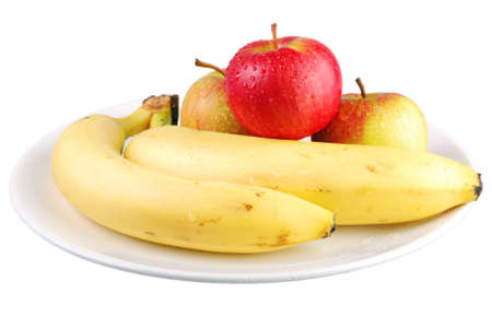 Fresh apples and bananas on a white plate with white background photo