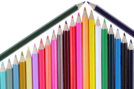 Colored pencils resembling a part of a house with a roof isolated on a white background photo