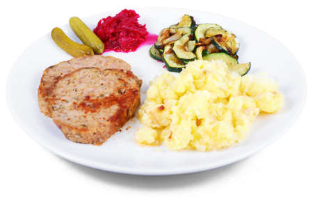 meat loaf: Plate of freshly cooked meat loaf with mashed potatoes and vegetable garnish Stock Photo