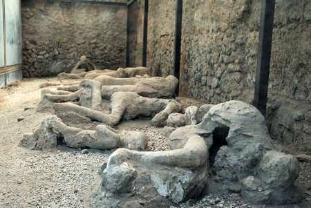 Pompeian victims - plaster was used to fill in the excavated voids in the ash layers that once held human bodies - victims to the eruption of Mount Vesuvius in 79 AD Stock Photo