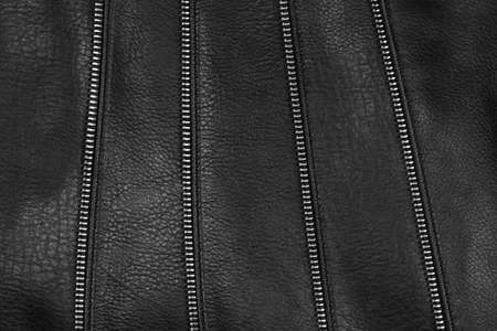 Black leather texture detail with decorative zips photo