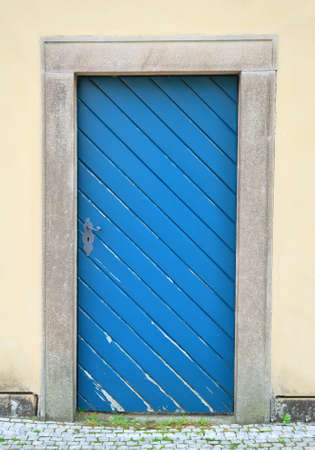 Blue old door in a building wall photo