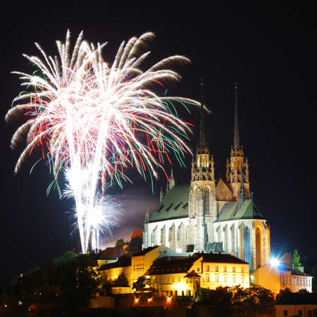 Gothic medieval cathedral with fireworks above photo