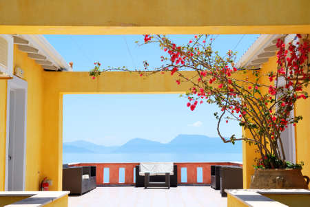 Balcony with sea view and bougainvillea flowers in bloom Stock Photo