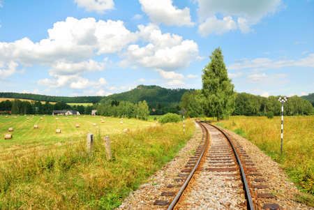 Railway tracks in a beautiful countryside landscape photo