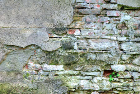 Old obsolete stone wall texture photo