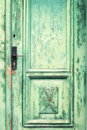 Old and weathered green door texture Stock Photo