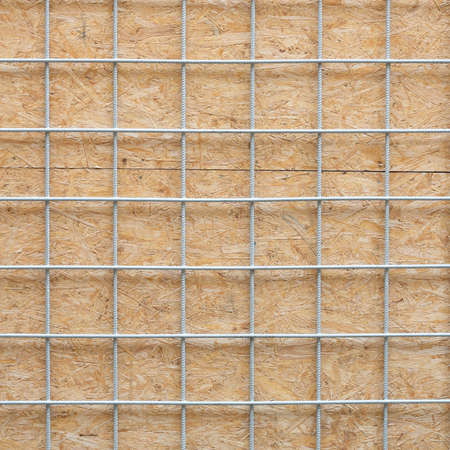 Metal grid and wooden board texture photo
