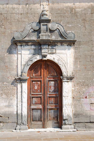Old weathered door of a small greek church photo