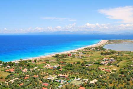 Long sandy beach on the island of Lefkada, Greece photo