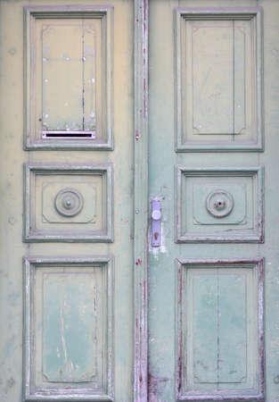 Old rustic light green wooden door photo