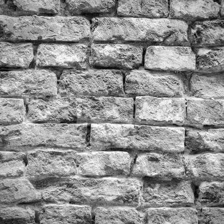 battered: Old weathered and battered brick wall texture in black and white tone Stock Photo