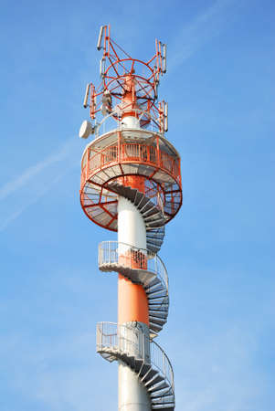 the antennae: High lookout tower with stairs and telecommunications antennae Stock Photo