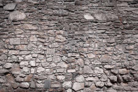 古い城の石壁のテクスチャ背景 写真素材