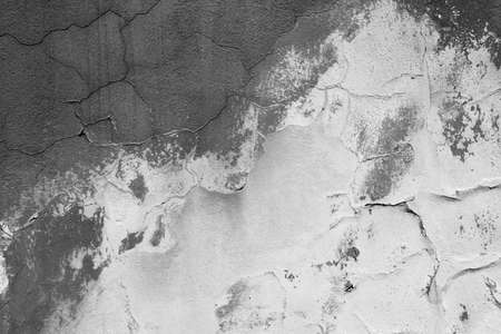 smudgy: Weathered plaster wall texture in black and white contrast Stock Photo
