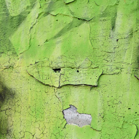 flaky: Green sprayed surface on an old flaky wall Stock Photo