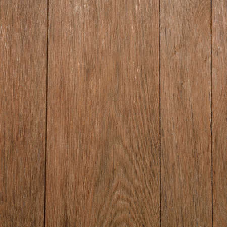 impregnated: Brown wooden desk texture closeup