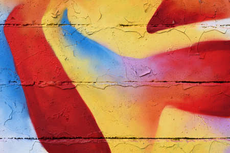 flaky: Colorful graffiti sprayed on an old flaky wall