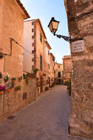Narrow street in the historic village of Valldemossa on Majorca, Spain