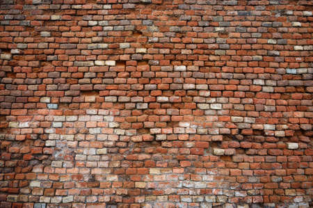 Old and damaged brick wall texture background Stock Photo