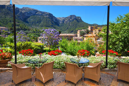 Garden restaurant with mountains view and Jacaranda trees Stock Photo