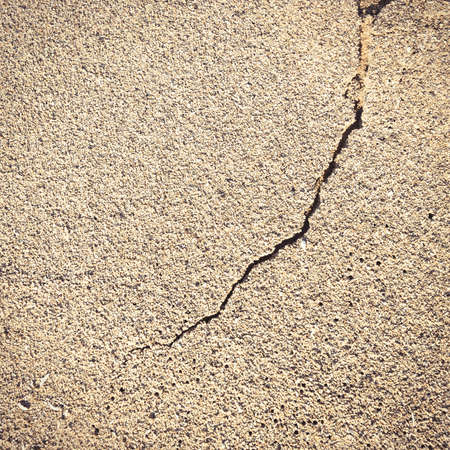 Flat and cracked sandy beach surface texture Stock Photo
