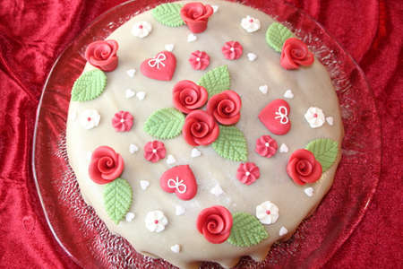 Wedding cake decorated with roses and hearts