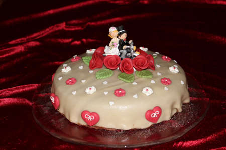 Newlyweds with Motorcycle on Wedding Cake