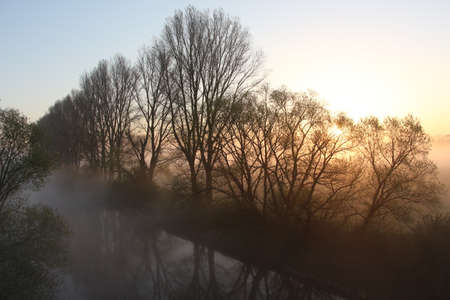 Mist over the river at sunrise