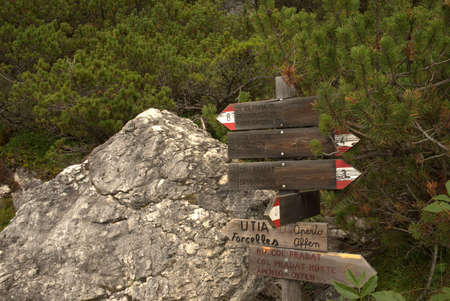 Signpost for hikers at a turn-off in the mountains Фото со стока
