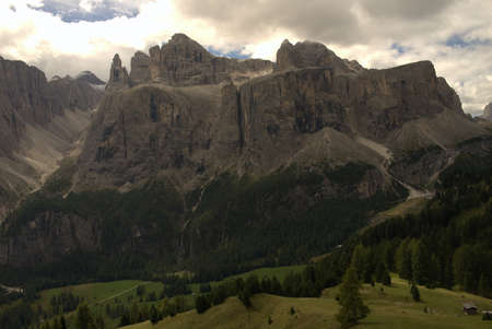 View of a massif in the valley Alpine meadows and forest in the Italian Dolomites Фото со стока