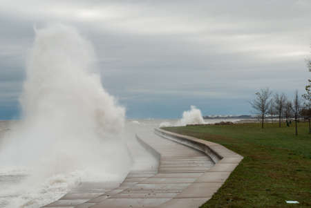 onslaught: Chicago embankment under the onslaught of the waves Stock Photo