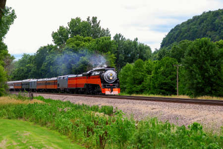One of the last steam engine rushes on the bank of Mississippi river