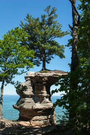 pictured: Chapel Rock  view from the coast, Pictured Rock National Lake Shore, Michigan, USA Stock Photo