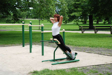 joyfulness: Woman doing morning exercises outdoors