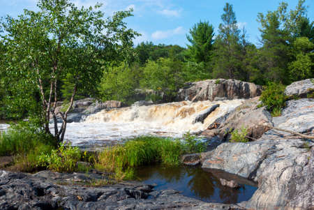 eau: Striped and spotted boulders on the banks of the Eau Claire River, Wisconsin, USA Stock Photo