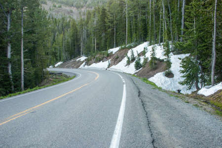 melts: Snow on the roadside in Yellowstone National Park is not melts even in the summer Stock Photo