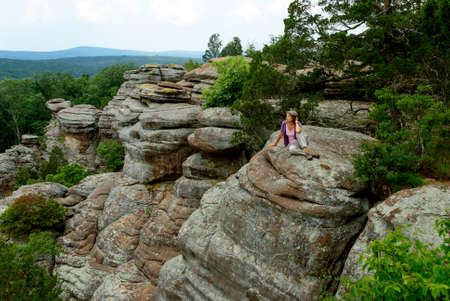 Stock Photo   Woman Sitting On The Edge Of A Cliff In The Garden Of The  Gods Wilderness In Shawnee National Forest, Illinois, USA