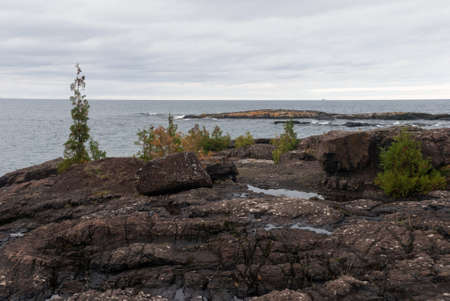 View at Superior Lake from the Black Rocks of Presque Isle Park, Marquette, Michigan, USA Stock Photo