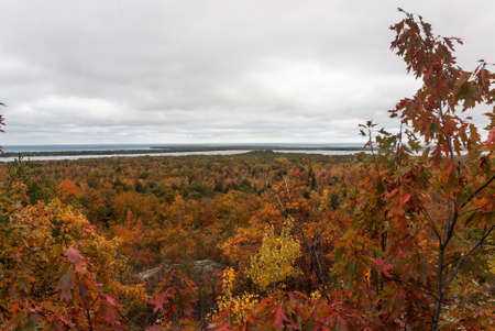 A view of an autumn forest and Lake Superior from Thomas Rock, Marquette County, Michigan, USA Stock Photo