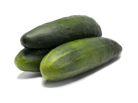 Three whole cucumbers stacked on top of each other.Completely clean. Ready for further processing. Banque d'images